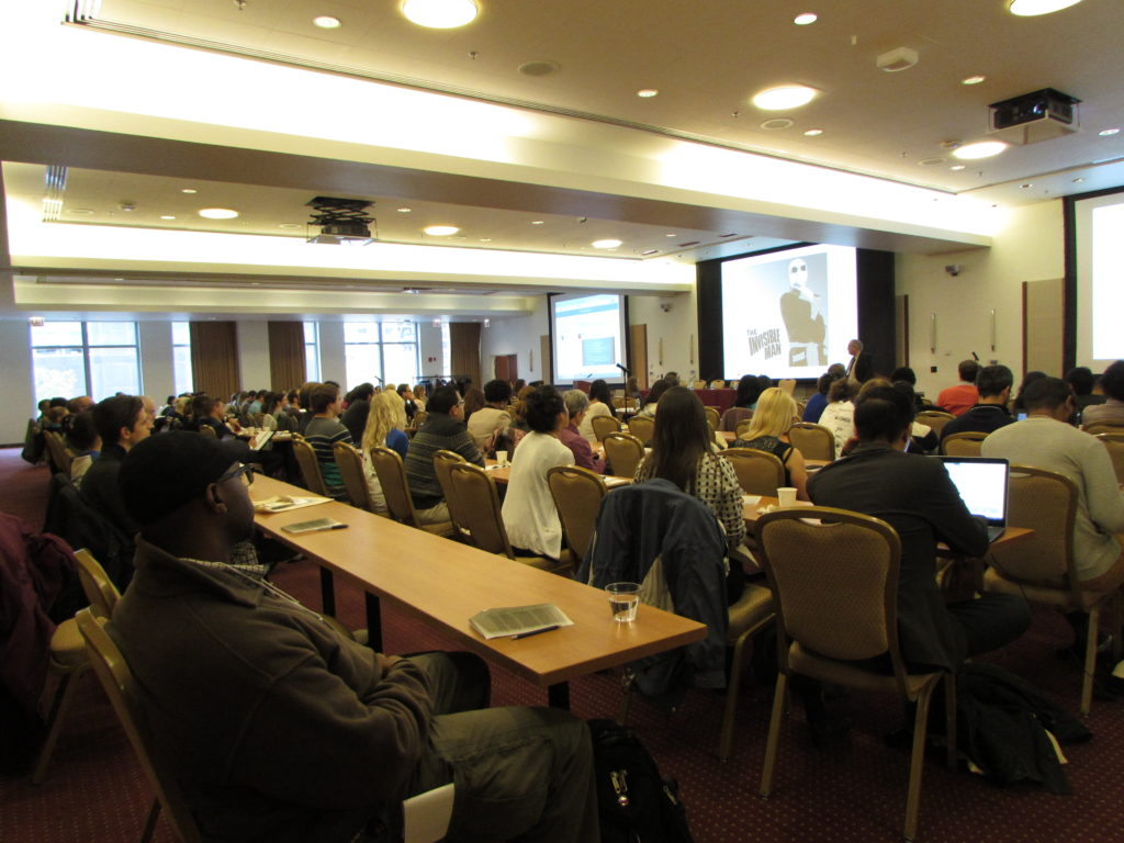 """FoR Chicago attendees listening to Greg Petsko's talk on """"The Invisible Postdoc"""". By Natasha Wadlington"""